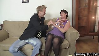 Old grandma in stockings is fucked on the couch
