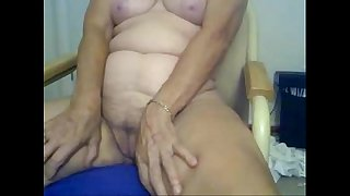 Horny granny fingering in front of cam. Amateur older