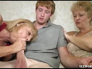 Two Blonde Grannies Suck A Big Cock