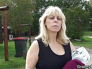 Old hot granny fucks younger guy in public