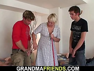 Blonde granny takes two cocks from both sides