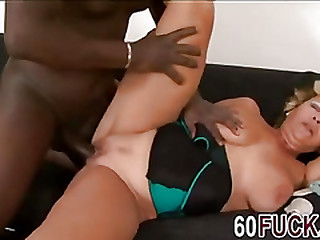 Blonde granny Sarah fucks a black man.