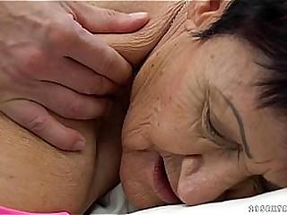 Granny eats a young guy's cum