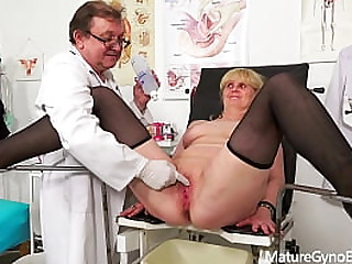 Blonde granny on her gynecological examination by freaky doctor