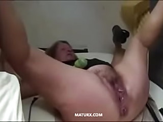 Big granny is toying her cunt with a big dildo and rubbing clit with a vibrator till squirt