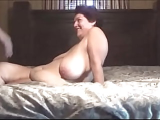 Black stud is fucking a very big granny with huge flaccid tits