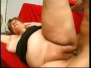 Fat blonde granny rides young cock